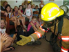 Fireman in full gear meets kids