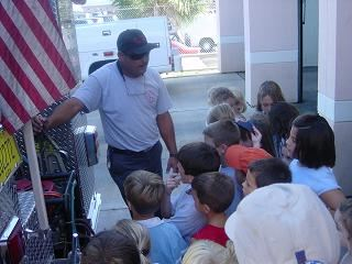 Fireman meets with kids