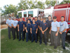 Group of Fire Academy Teens and Instructors by Fire Truck