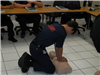 A Youth Performing CPR in Class