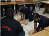 Two Young Men Performing CPR on Dummy