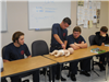 Youth Performing CPR on Doll