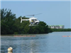 Helicopter flies over water